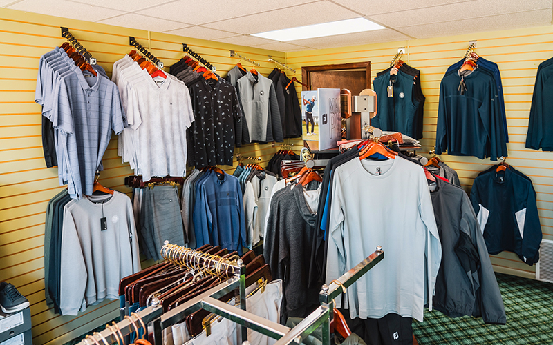 different clothing, clubs and hats in the pro shop of Bemidji Town and Country Club